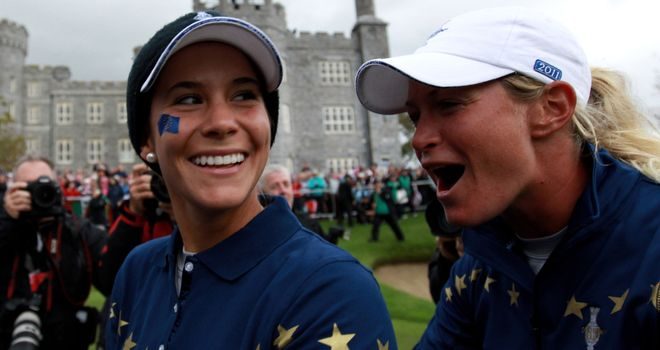 Azahara Munoz and Suzann Pettersen celebrate their team's dramatic 15-13 victory