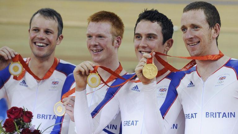 Sir Bradley Wiggins, right, celebrating winning one of two gold medals at the 2008 Olympic Games