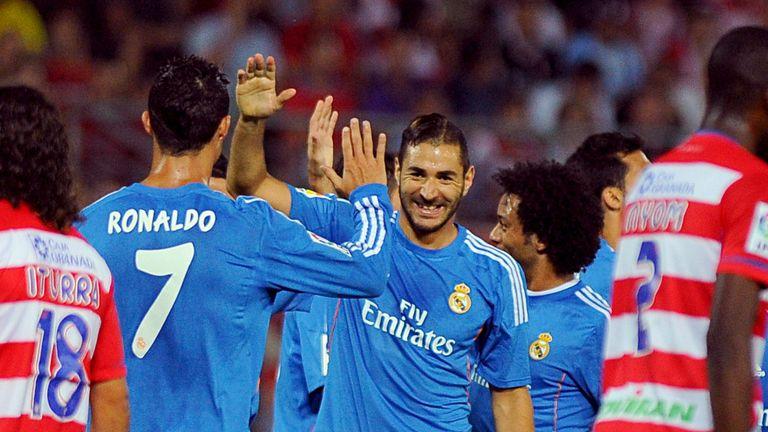 Karim Benzema: Celebrates Real's winner with Cristiano Ronaldo
