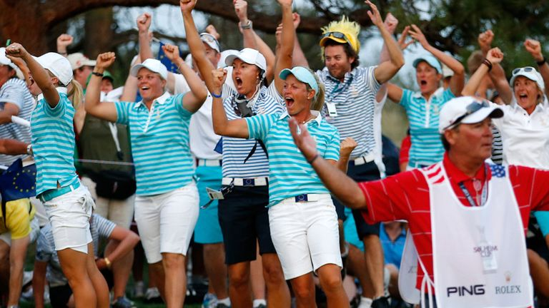 Europe celebrate Karine Icher's putt on the 18th.