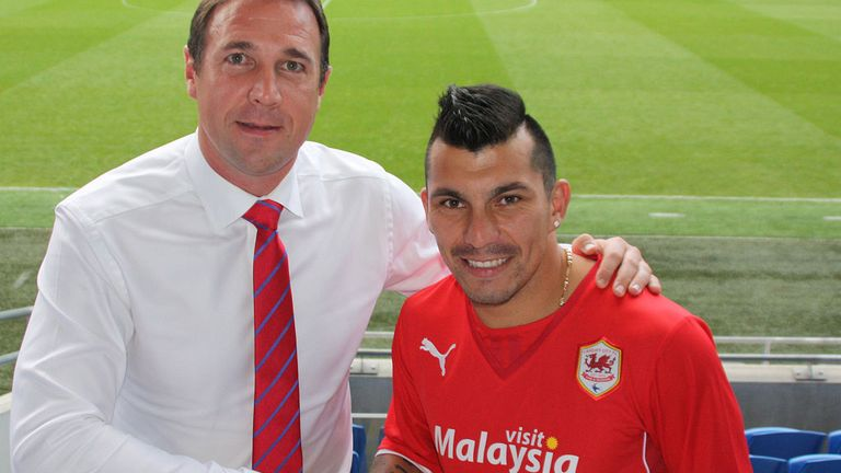 Malky Mackay welcomes his new signing (pic courtesy of Cardiff City FC)
