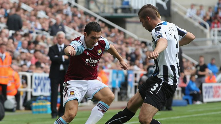 Stewart Downing takes on Davide Santon at St James' Park