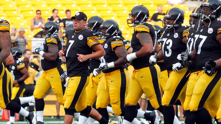 Quarterback Ben Roethlisberger leads the Pittsburgh Steelers warm up.