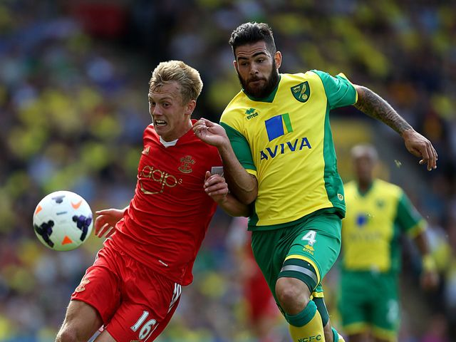 James Ward-Prowse and Bradley Johnson tangle.
