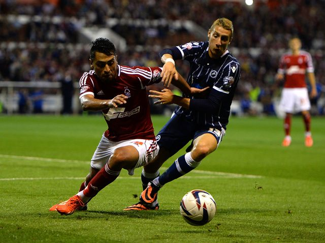 Gonzalo Jara of Nottingham Forest battles with Lee Martin