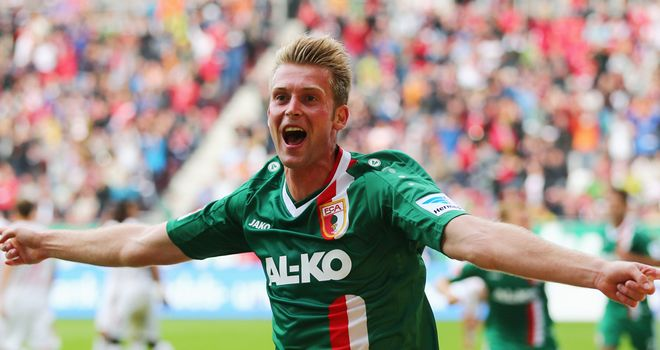 Jan Ingwer Callson Bracker celebrates his goal for Augsburg