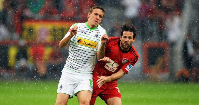 Max Kruse tussles with Gonzalo Castro