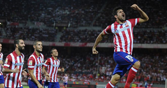 Jumping for joy: Atletico madrid's two-goal hero Diego Costa