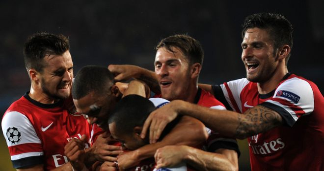 Kieran Gibbs: Is mobbed after scoring Arsenal's opening goal