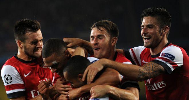 Kieran Gibbs: Is mobbed after scoring Arsenal's opening goal