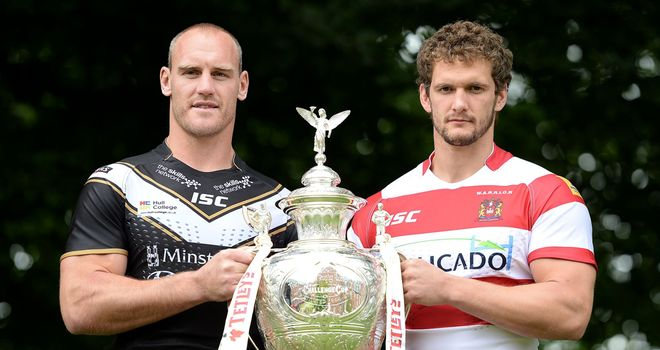 Gareth Ellis and Sean O'Loughlin get their hands on the cup