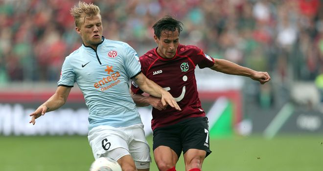 Johannes Geis and Edgar Prib battle for the ball