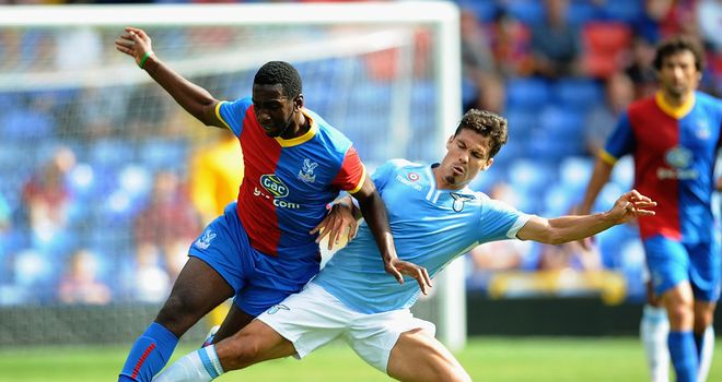 Yannick Bolasie of Palace competes for the ball with Hernanes of Lazio