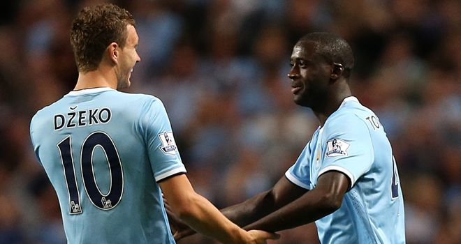 Yaya Toure celebrates with Edin Dzeko after his free-kick made it 3-0
