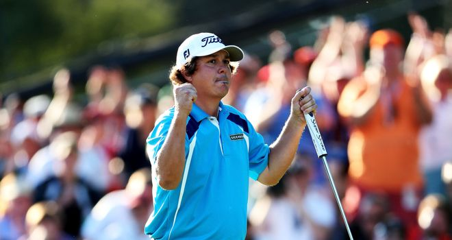 Jason Dufner celebrates after tapping in for a two-shot victory