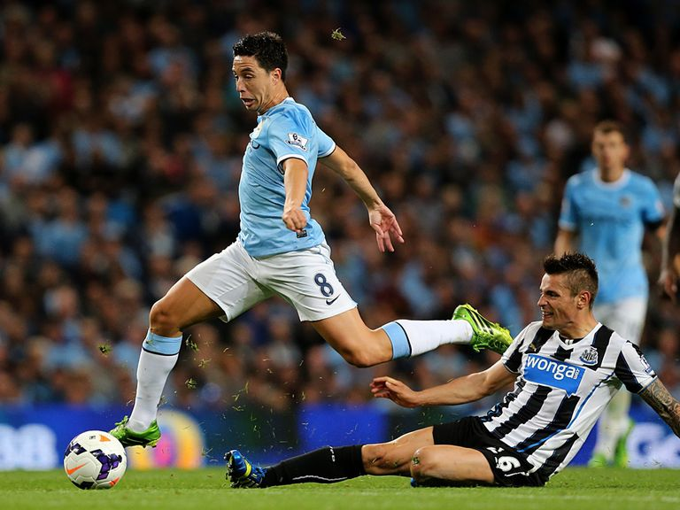 Nasri on his way to scoring City's fourth