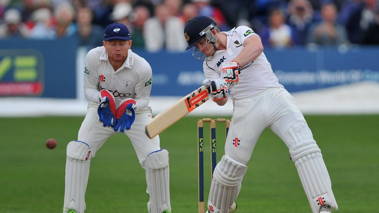 Ben Brown cuts for four as wicketkeeper Jonny Bairstow looks on