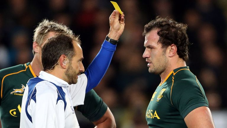 Romain Poite shows yellow card to Bismarck du Plessis