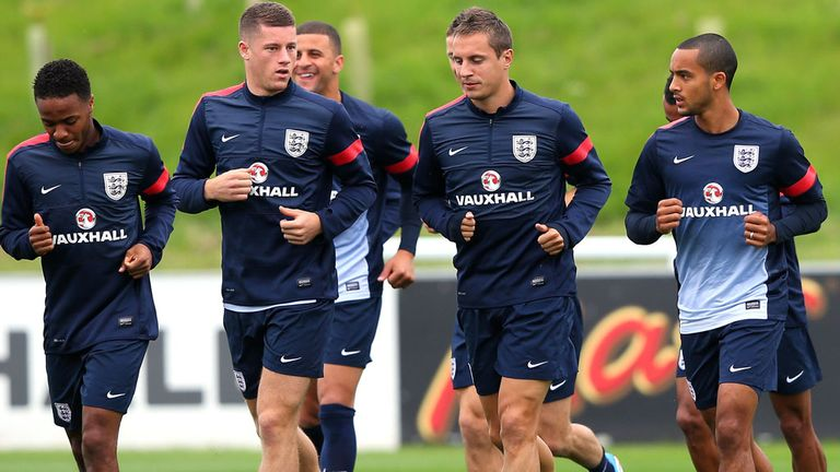 Theo Walcott (far right) training with the England squad on Tuesday morning