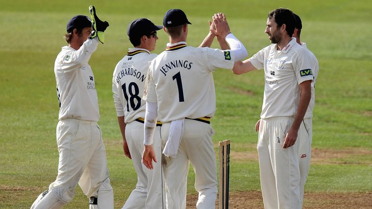 Champions-elect Durham celebrate another Nottinghamshire wicket