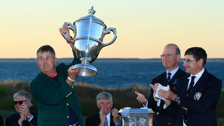 Victorious US captain Jim Holtgrieve holds the Walker Cup aloft