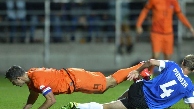 Robin van Persie takes a tumble