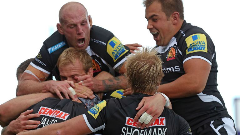 Exeter Chiefs players celebrate with tryscorer Tom James