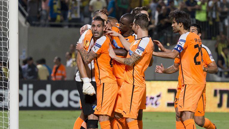 APOEL Nicosia celebrate Urko's penalty save