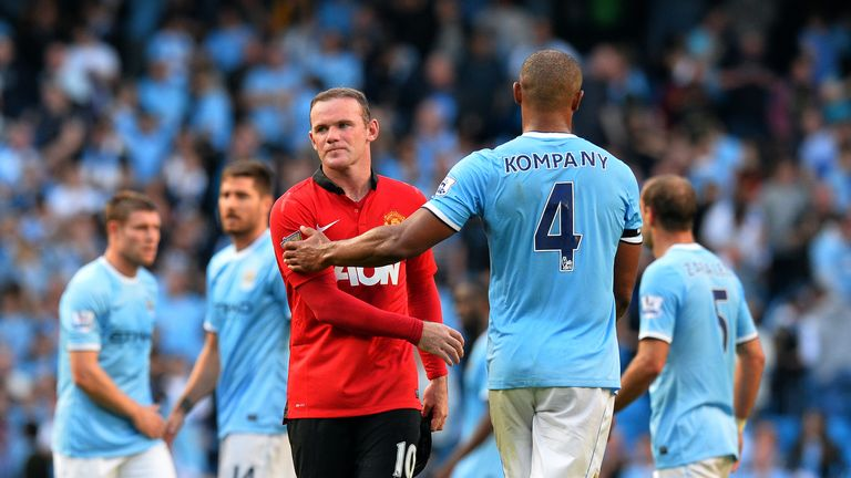 Wayne Rooney congratulates Vincent Kompany after 4-1 defeat