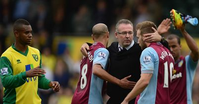 Paul Lambert congratulates his players after Norwich win