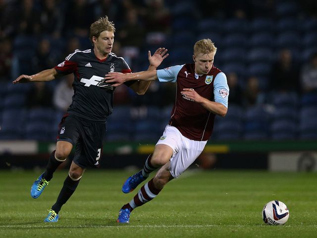 Ben Mee keeps track of Dan Harding
