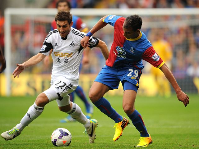 Angel Rangel and Marouane Chamakh battle for the ball