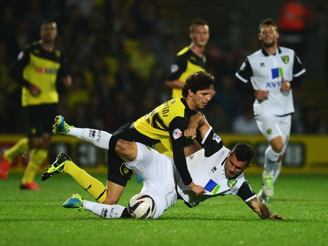 Diego Fabbrini and Bradley Johnson tumble.