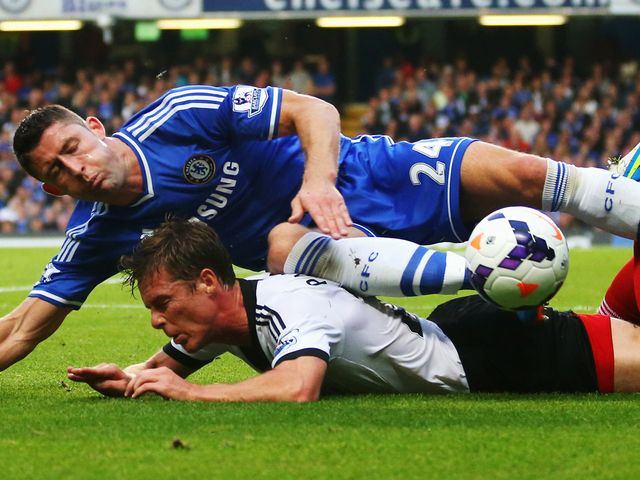 Gary Cahill and Scott Parker tumble.