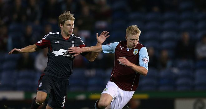 Ben Mee: Tussles for the ball with Dan Harding