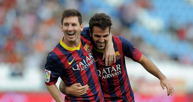 Lionel Messi celebrates with Cesc Fabregas