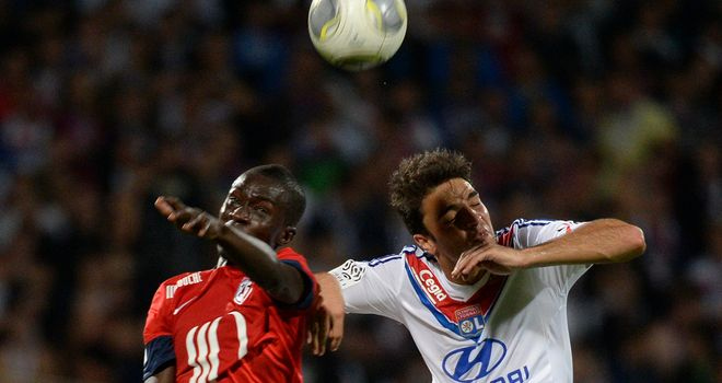 Idrissa Gueye vies for the ball with Clement Grenier