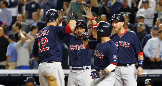 Boston Red Sox celebrate Mike Napoli's grand slam in Friday's win over the New York Yankees