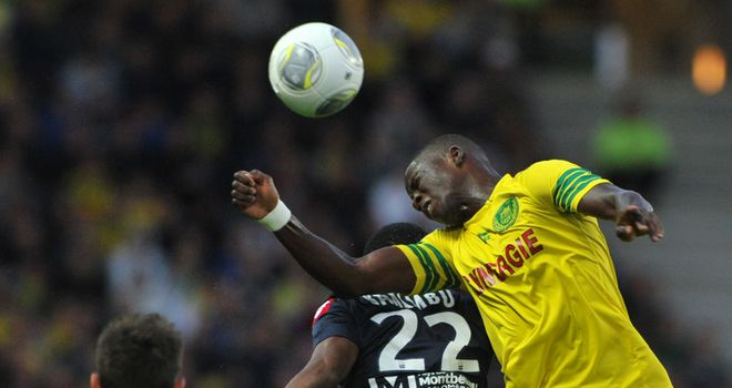 Papy Mison Djilibodji (right) wins a header for Nantes