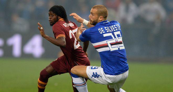Gervinho tries to escape De Silvestri.
