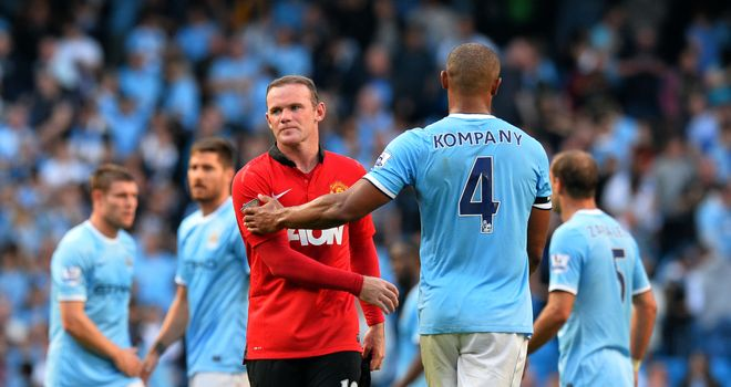 Vincent Kompany shakes hands with Wayne Rooney after the Derby