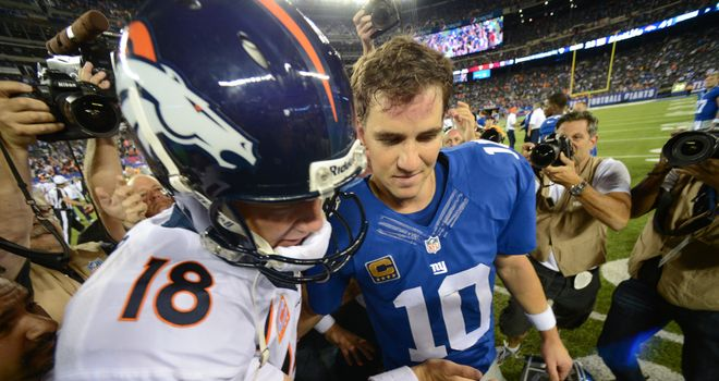 Peyton Manning (left) shakes hands with his brother Eli