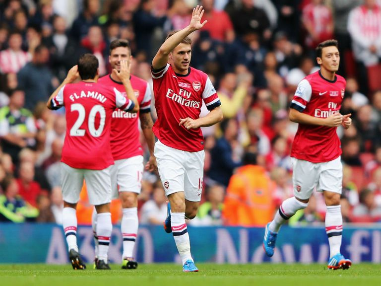 Arsenal celebrate during their victory over Stoke