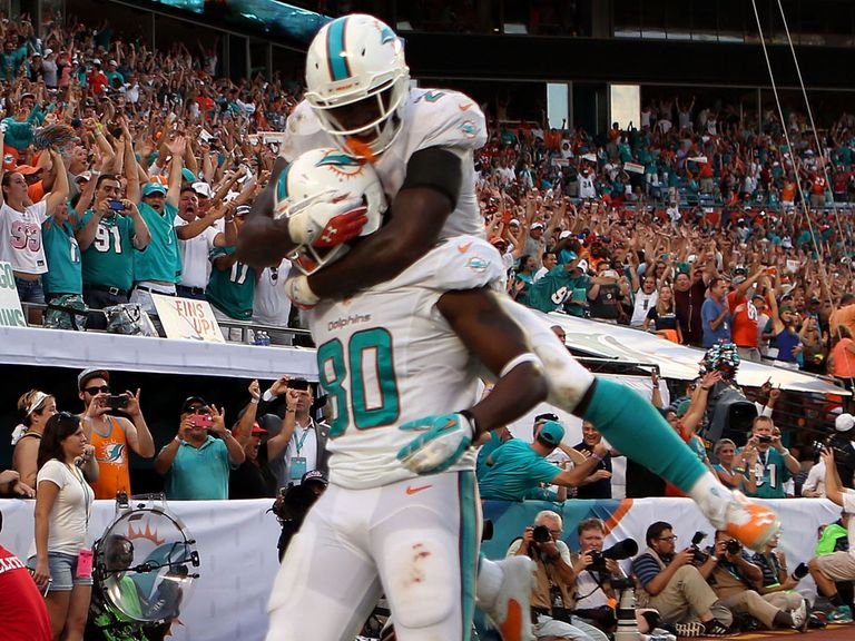Dion Sims celebrates his winning touchdown
