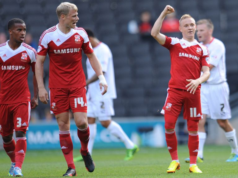 Alex Pritchard celebrates his free-kick strike for Swindon