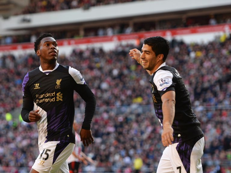Luis Suarez says he is pleased to be playing with Sturridge