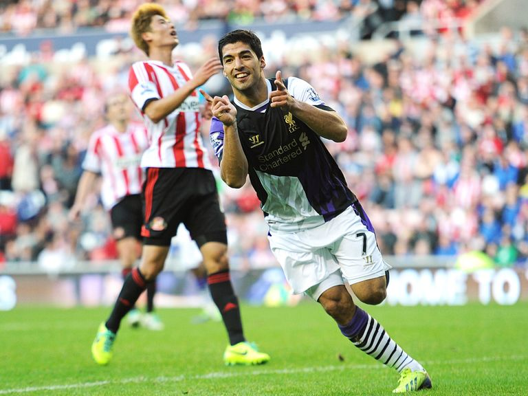 Suarez scored twice as Liverpool climbed to second in the table