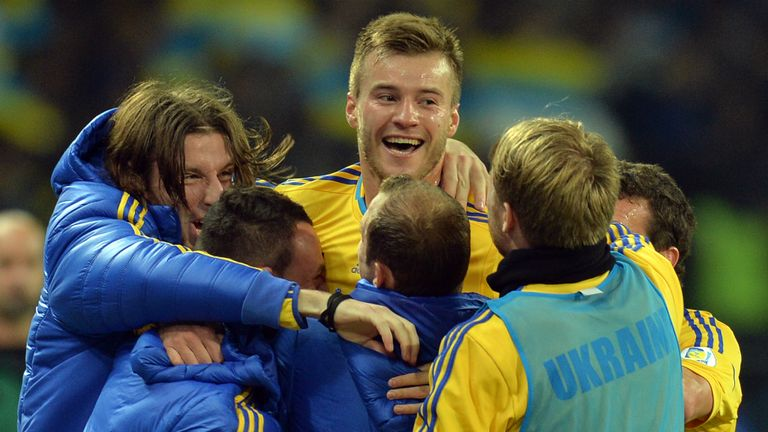 Andriy Yarmolenko: Celebrates with his team-mates as Ukraine keep their World Cup dream alive