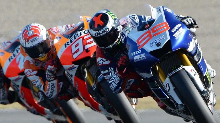 Jorge Lorenzo (R) keeps his nose in front of Marc Marquez in Japan