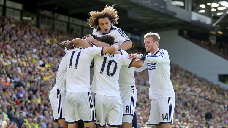 Chelsea: The Blues celebrate after Oscar opened the scoring at Carrow Road